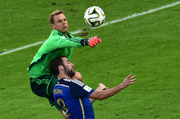 Germany's goalkeeper Manuel Neuer (L) and Argentina's forward Gonzalo Higuain compete for the ball during the final football match between Germany and Argentina for the FIFA World Cup at The Maracana Stadium in Rio de Janeiro on July 13, 2014. AFP PHOTO / NELSON ALMEIDA (Photo credit should read NELSON ALMEIDA/AFP/Getty Images)