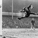Chelsea goalkeeper Peter Bonetti makes a flying save, watched by team mate Eddie McCreadie.