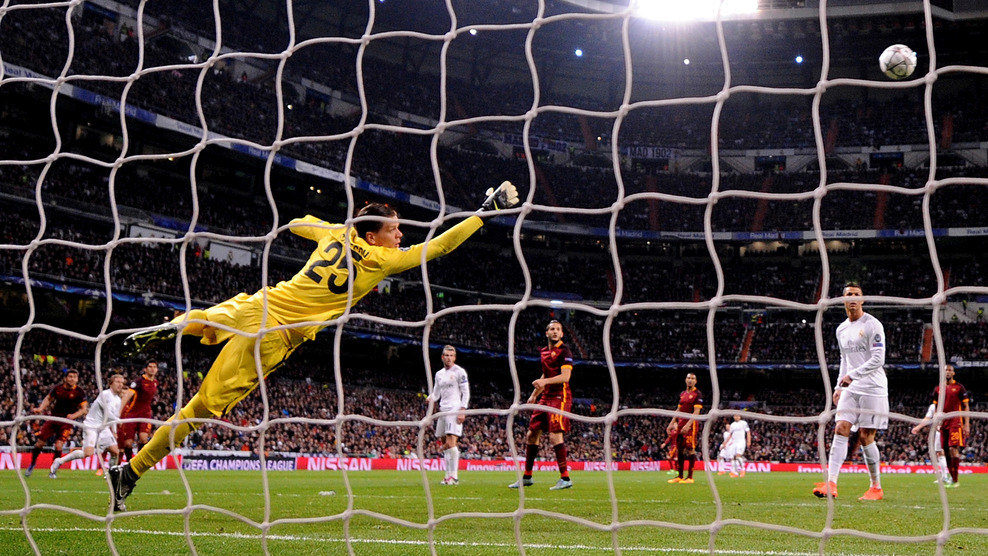 """MADRID, SPAIN - MARCH 08:  Wojciech Szczesny of AS Roma dives to save a shot on goal during the UEFA Champions League Round of 16 Second Leg match between Real Madrid CF and AS Roma on March 8, 2016 in Madrid, Spain.  (Photo by Denis Doyle/Getty Images)"""