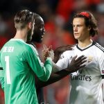 Benfica's Mile Svilar is consoled by Manchester United's Romelu Lukaku and David De Gea after the match. Reuters/Carl Recine